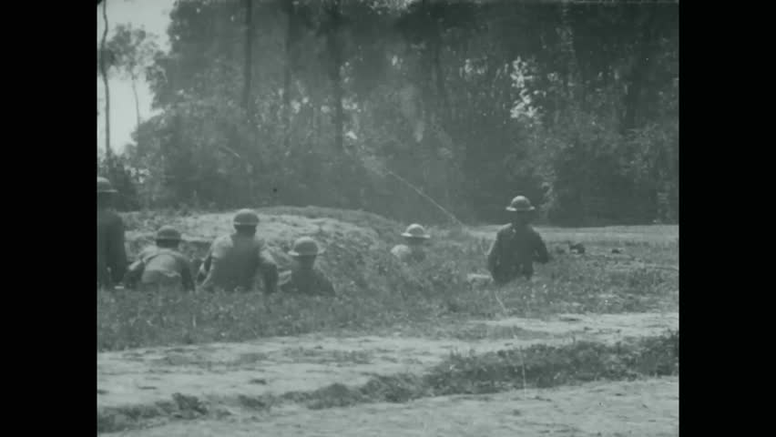 CIRCA - 1918 - Soldiers practice throwing hand grenades in trenches, and military officers make plans during WWI.