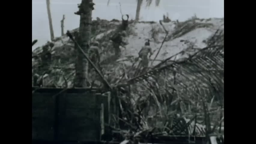 CIRCA 1944 - The Marines use hand grenades and flamethrowers to kill Japanese soldiers in the Battle of Tarawa in the Pacific during WWII.