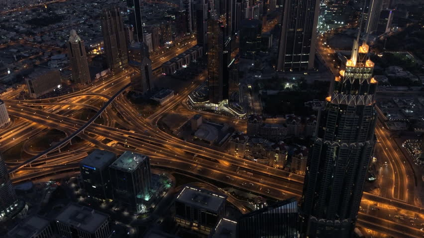 Aerial Shot Of Dubai Skyline And Traffic At Night