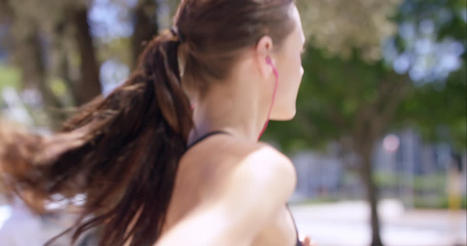 Athletic fitness woman running in urban city RED DRAGON