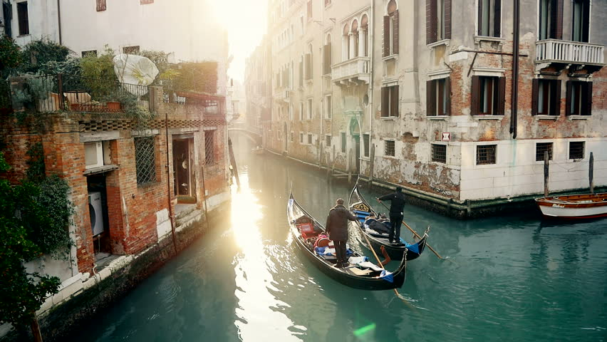 Magic drone shot of Venice with gondola in canal | Shutterstock Video #10215728