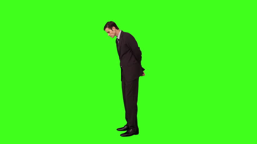 Businessman standing and looking down on green screen background | Shutterstock HD Video #10380050