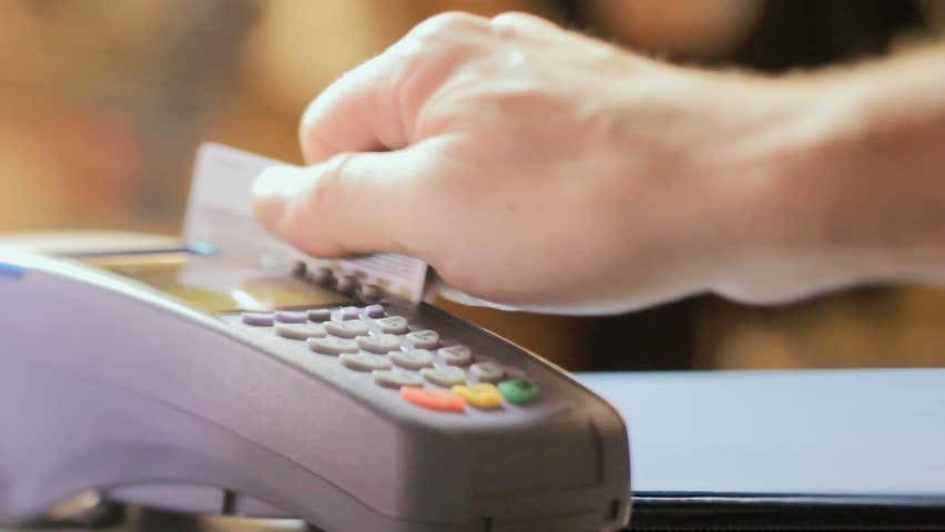 Credit card sale transaction, swiping card through terminal machine  | Shutterstock HD Video #10386686