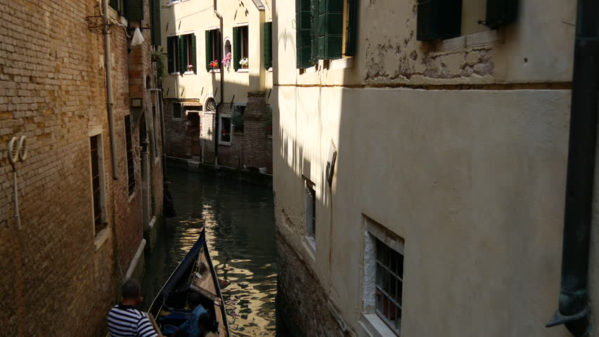 Gondola in a narrow canal in Venice Italy | Shutterstock HD Video #10429202