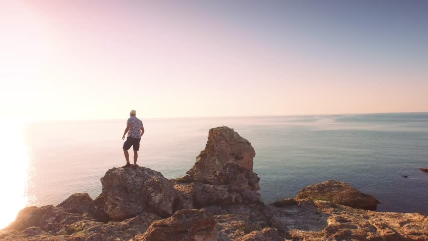Aerial Of Young Handsome Businessman Silhouette Walking Standing On Ocean Cliff Edge Sea Vacation Happiness Concept