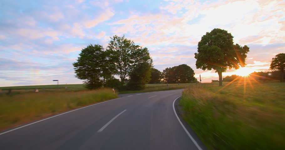 Driving a car - POV - 4K+ - Road into the Sunset - Part 7 of 7 Shot on roof-mounted Sony PXW FS7 This shot was split into a series of takes, that can be put back together for the original length clip  | Shutterstock HD Video #10522073