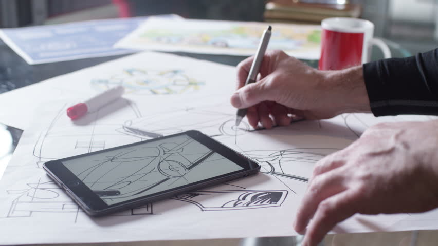4K Hands using computer tablet with creative automotive design drawings