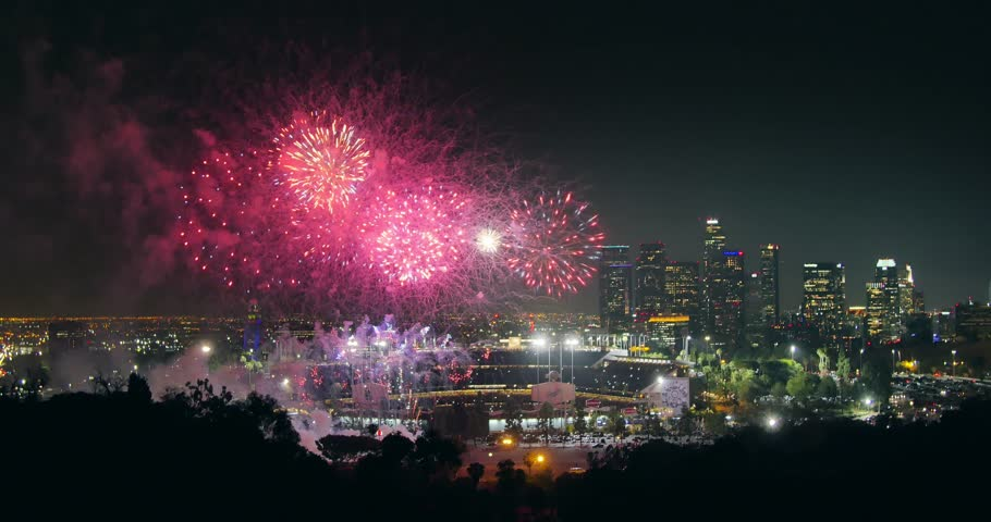 LOS ANGELES - June 2015: Fireworks display over city of Los Angeles downtown skyline at night. 4K UHD.