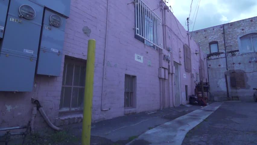Parkour / Freerunning Wall Flip in Grunge Alleyway Slow Motion