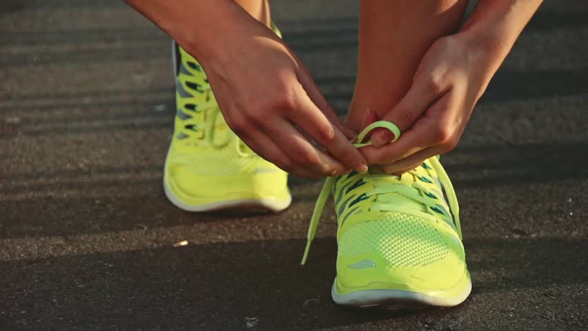 Slow Motion Running Shoes Barefoot Running Shoes Closeup Female Athlete Tying Laces -5303