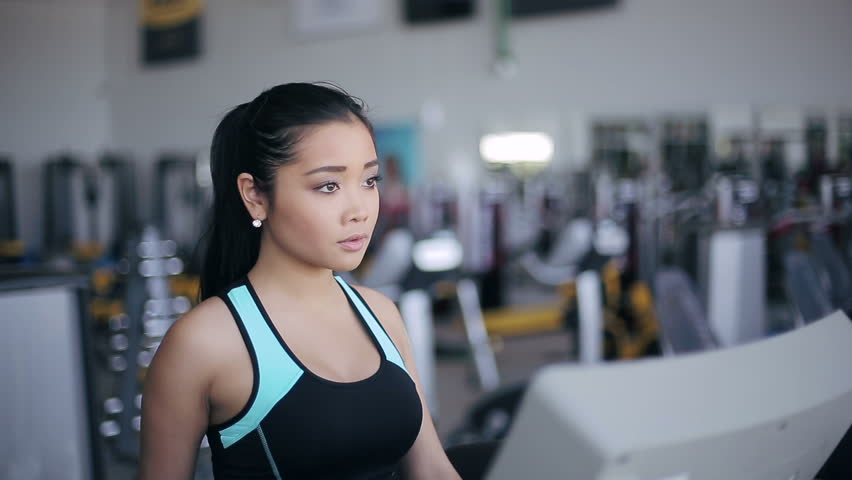 Attractive Asian Girl Running On The Treadmill In The Gym Right Profile Face Stock -8558
