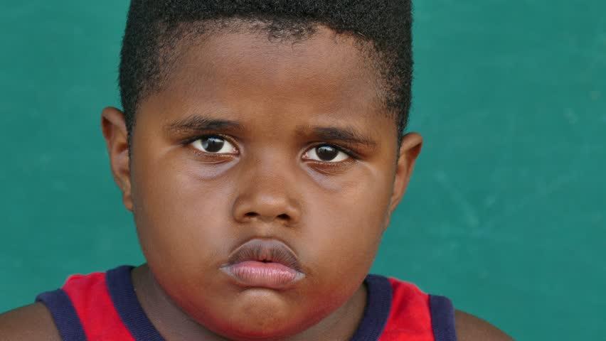 Overweight Black Kids Portrait Of Sad...