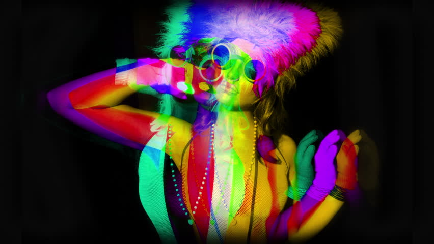4k sequence of fantastic shots of different sexy cyber raver dancer babes filmed in fluorescent clothing under UV black light | Shutterstock HD Video #10769471