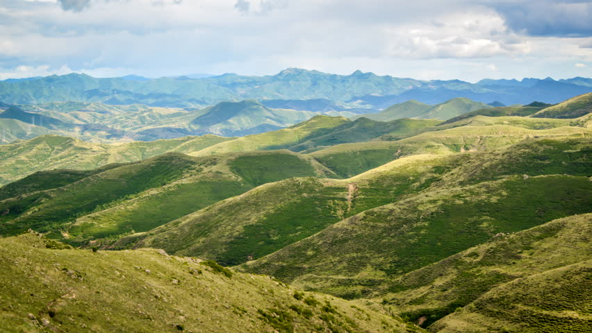 Timelapse.Grassland and Mountains with Clouds and Shadows. | Shutterstock HD Video #10822541