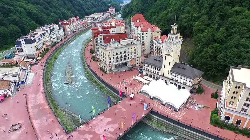 SOCHI, RUSSIA - JULY 2015: Riverside Rosa Khutor Alpine ski Resort in Krasnaya Polyana - popular center of skiing and snowboard, venue for the 2014 winter Olympics. Helicopter view. | Shutterstock HD Video #10868096