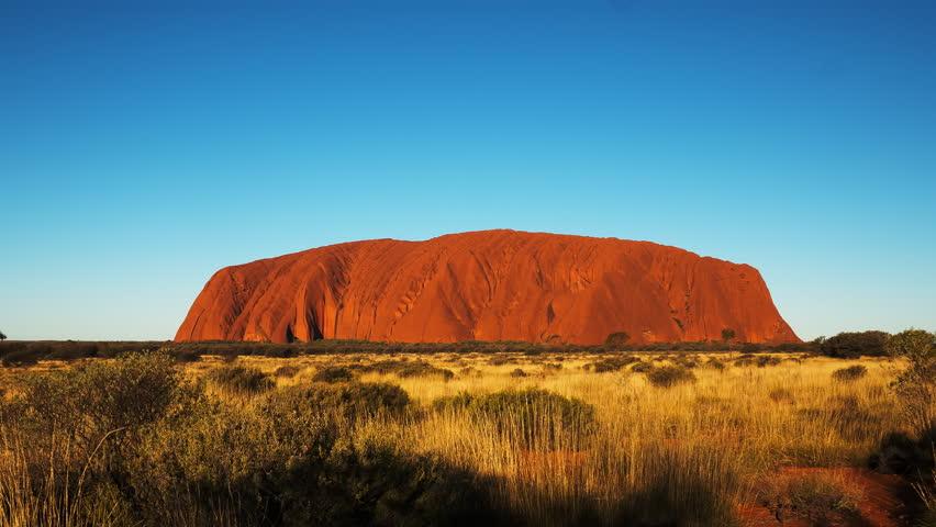 YULARA, AUSTRALIA - JUNE 17 2015: a time lapse of uluru/ayers rock in australia's northern territory at sunset