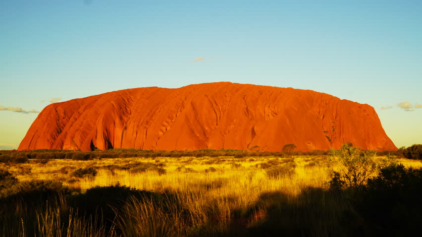 YULARA, AUSTRALIA - JUNE 17 2015: a close up of uluru/ayers rock in australia's northern territory at sunset