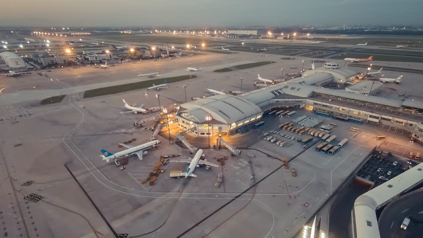 Timelapse.Aerial View.Airport Terminal at Sunset with Airplanes Taxiing and Landing. | Shutterstock HD Video #11158940