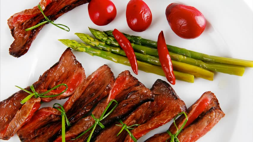 Grilled Red Beef Meat Rolls With Asparagus And Hot Spices On China Plate 1920x1080 Intro Motion