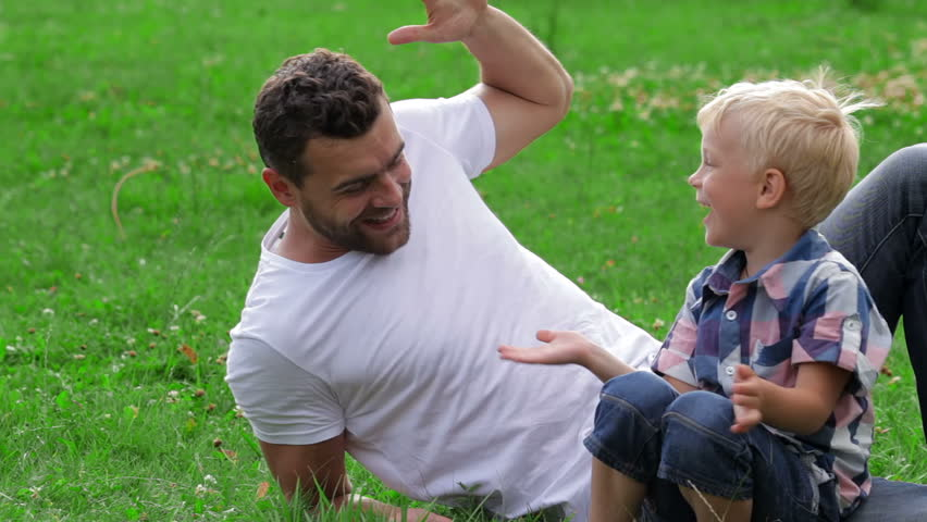 Image result for dad giving son high five