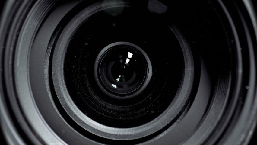 Camera lens zoom. Changing focal length. Front view macro shot.