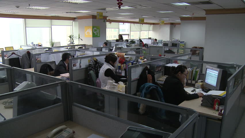 Chengdu, China - March 2010: A modern Chinese office with workers at their computers in cubicles in Chengdu, China. | Shutterstock HD Video #11509487