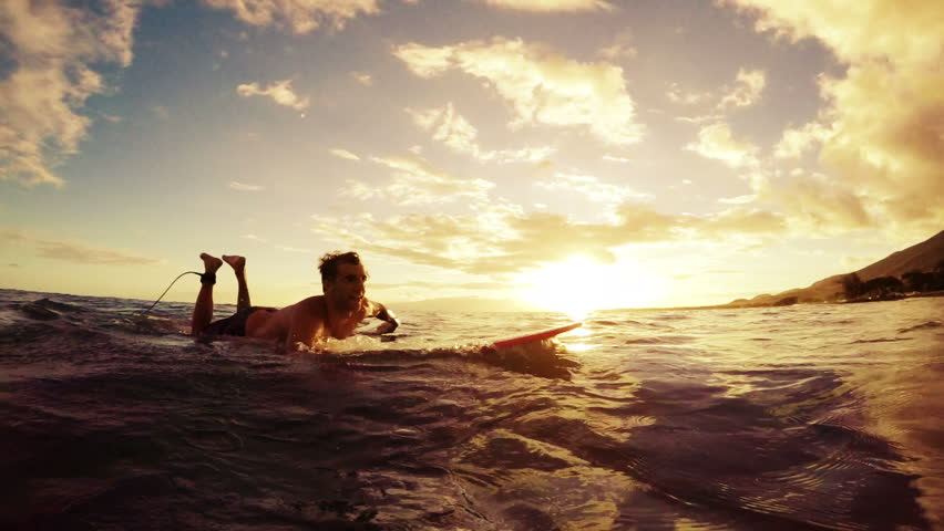 Young Man Paddles by the Camera on a Longboard Through the Sunset. Warm Tone. Slow Motion. Sun Flare Instagram Filter. POV Point of View | Shutterstock Video #11529350