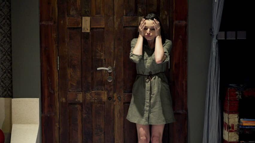 Girl Walks Into Door : Young woman open wooden entrance door at night and walking