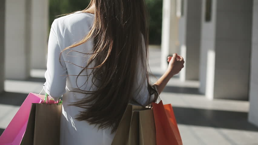 Sale, consumerism: Confident lady with shopping...