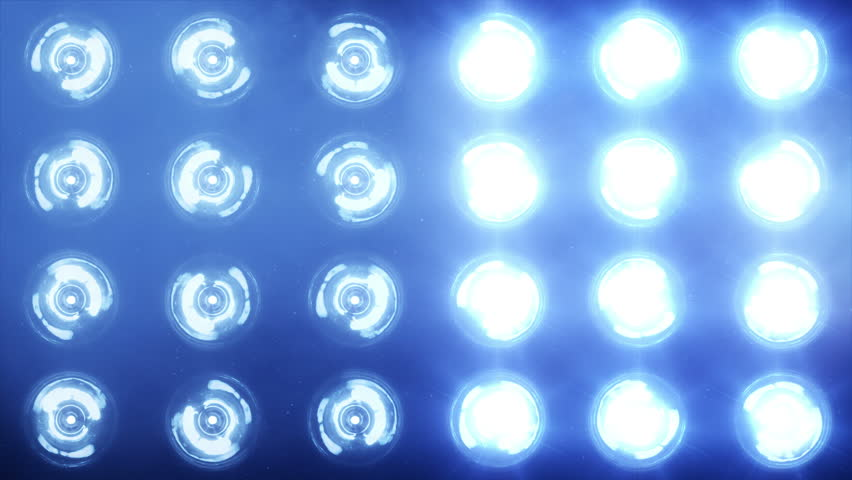 Stage lights. Close-up. Floodlights shining brightly and turning on and off. Blue. More color options in my portfolio.