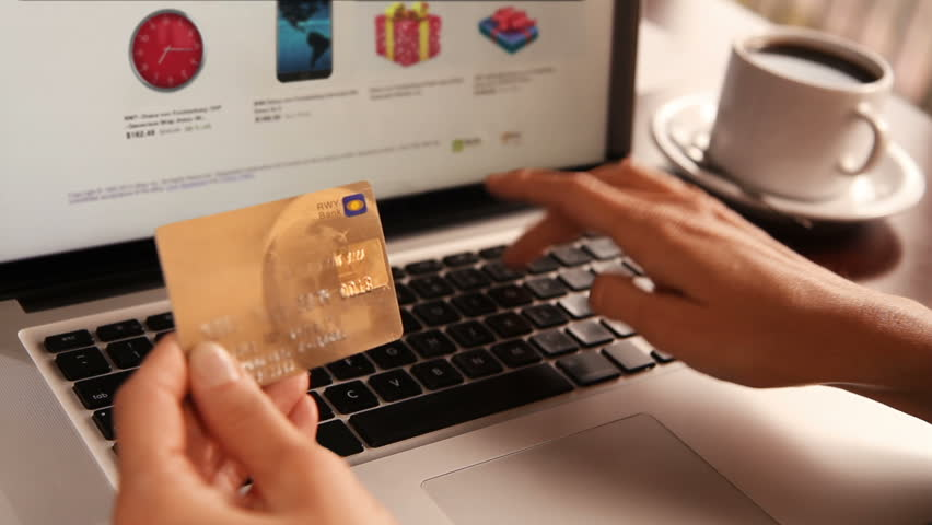 Online shopping. 3 shots. Dolly. Female hand holding a gold credit card and shopping online. More options in my portfolio. | Shutterstock Video #11744465