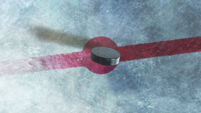 Hockey Puck Drop. animated puck drops from above and hits ice. 3 clips. 1st clip is puck drop on ice. 2nd clip is puck drop on black. 3rd clip is luma matte of puck to isolate it from the background.   Shutterstock Video #11834468