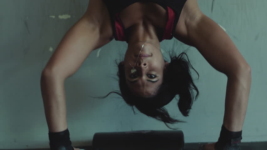 Close up of a Woman doing a Handstand