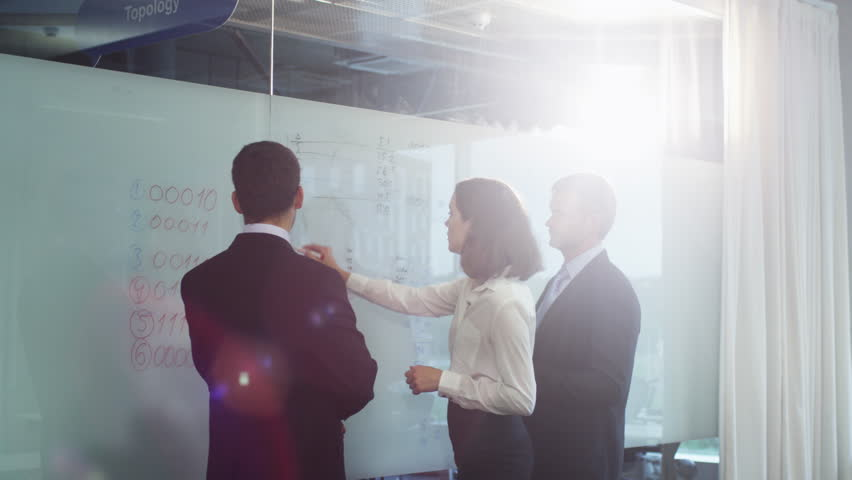 Team of Office Workers have Discussion near Glass Whiteboard. Shot on RED Cinema Camera in 4K (UHD).   Shutterstock HD Video #11917751