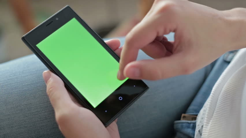 Woman hands touching and scrolling smartphone.green screen display   Shutterstock HD Video #12004040