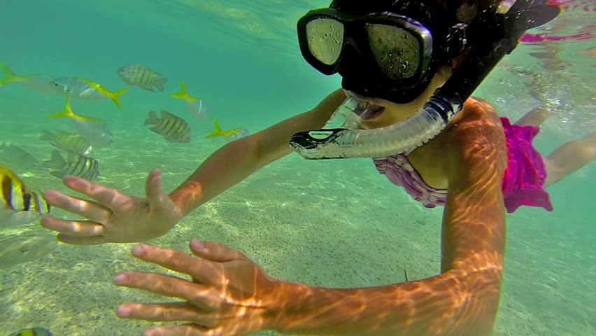 Girl snorkelling underwater | Shutterstock HD Video #12100454