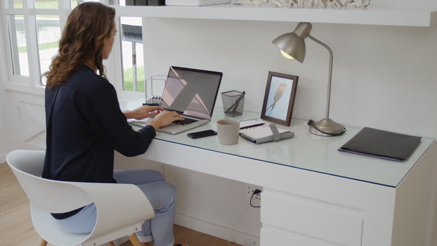 Stupendous Successful Woman Working In Modern Home Office With Laptop Largest Home Design Picture Inspirations Pitcheantrous