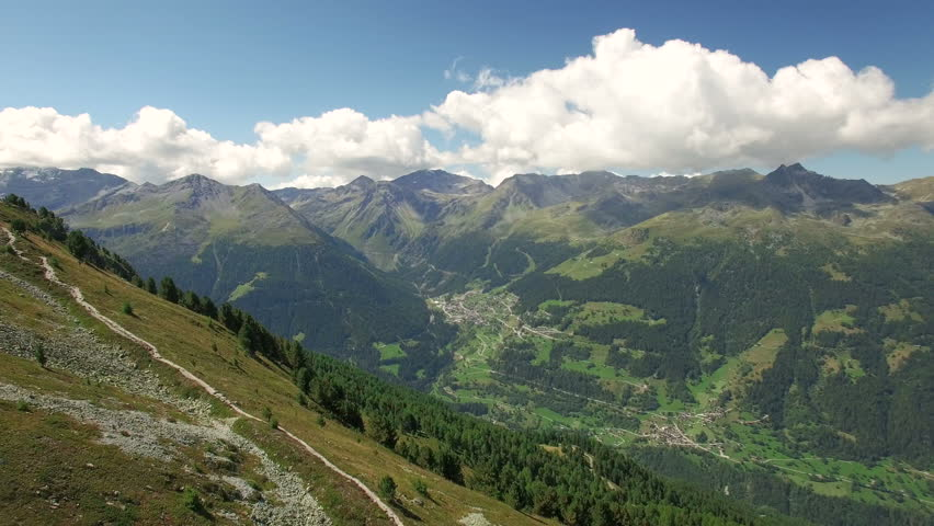 4K Breathtaking aerial panorama of the swiss alps / Into the wild in switzerland - beautiful alps and peaceful valley in the background