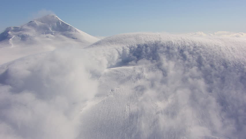MS AERIAL View of avalanche on Tordrillo snowy mountain peak / Alaska, United States
