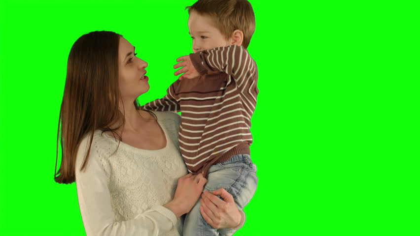 Happy family having fun.  on a Green Screen, Chroma Key. Professional shot on BMCC RAW with high dynamic range. You can use it e.g in your commercial video, family video, music video.   Shutterstock HD Video #12221909
