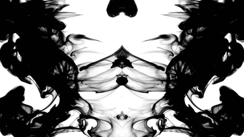 Black ink in water leaving screen like a disappearing Rorschach inkblot test,