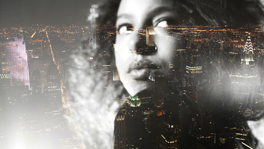 Afro girl double exposed over new york at night...