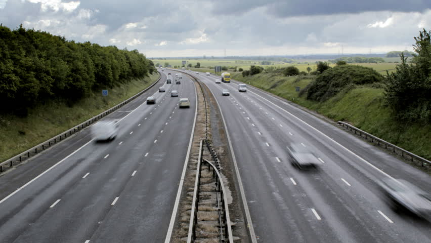 Timelapse of traffic on both carriageways of a British motorway. Easily flipped