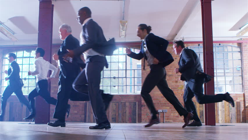 4K Diverse corporate business team running through urban industrial building. Shot on RED Epic. | Shutterstock HD Video #12421301