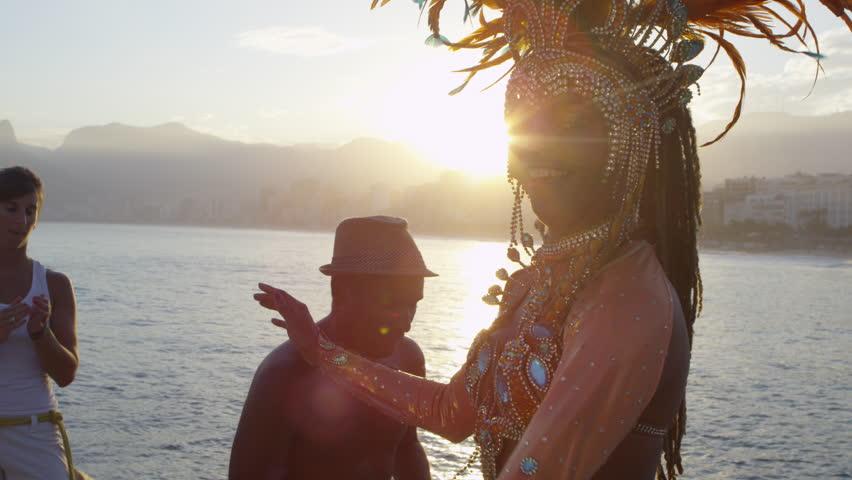 Woman dressed in carnival costume dancing   Shutterstock HD Video #12436820
