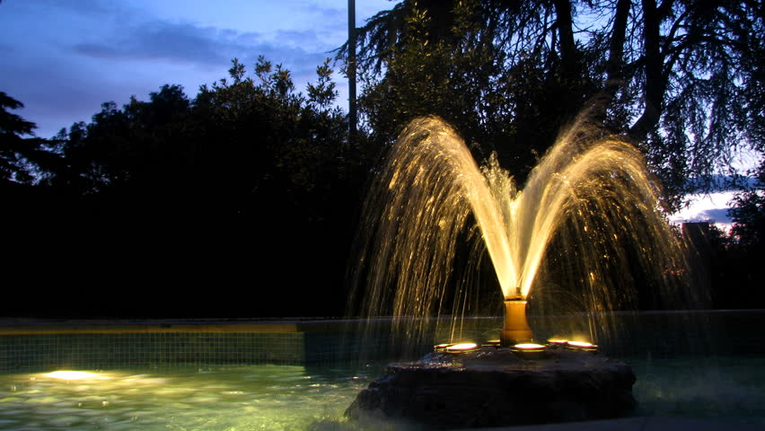 Illuminated fountain in the park,during the dusk. | Shutterstock HD Video #1246087