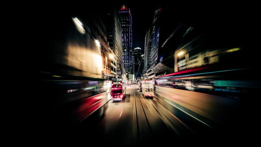 Time lapse moving through modern night city...