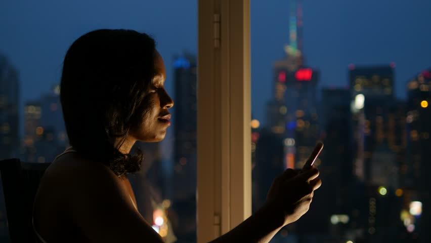 Black Women Using Tablet Pc Inside Apartment At Night Female