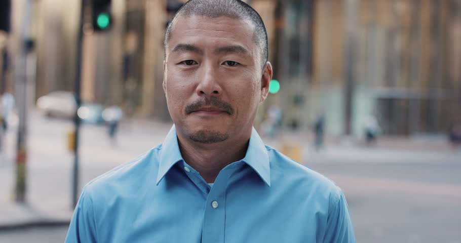 Slow Motion Portrait of Japanese businessman smiling in city real people series