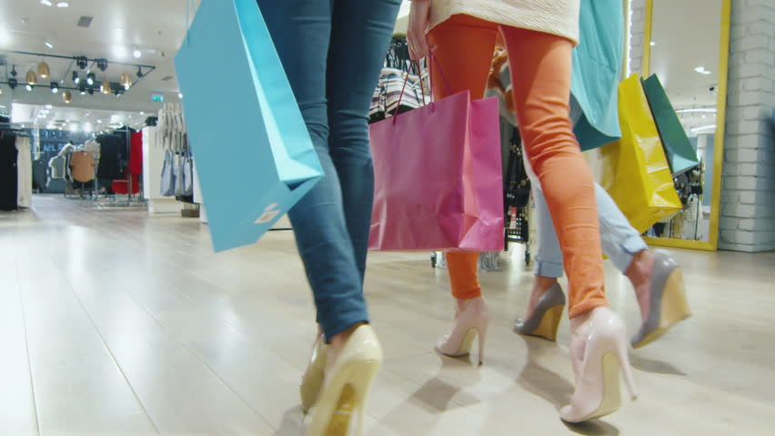 Low shot of female legs walking through a department store in colorful garments. Shot on RED Cinema Camera in 4K (UHD). | Shutterstock HD Video #12662948